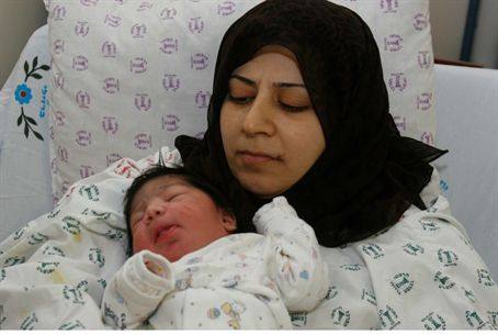 Gaza woman with baby in Israel (Illus.)