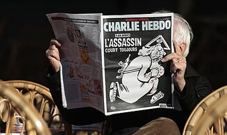 French police probing new Charlie Hebdo threats