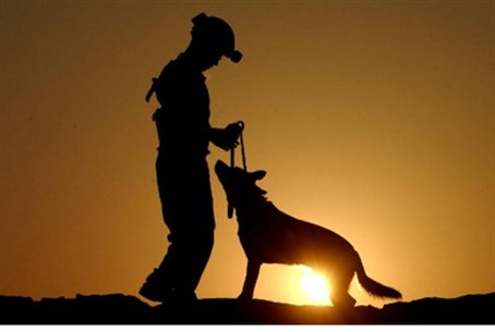 Soldier and dog (file).