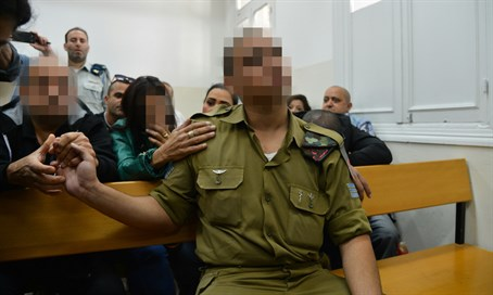 Soldier in court flanked by relatives
