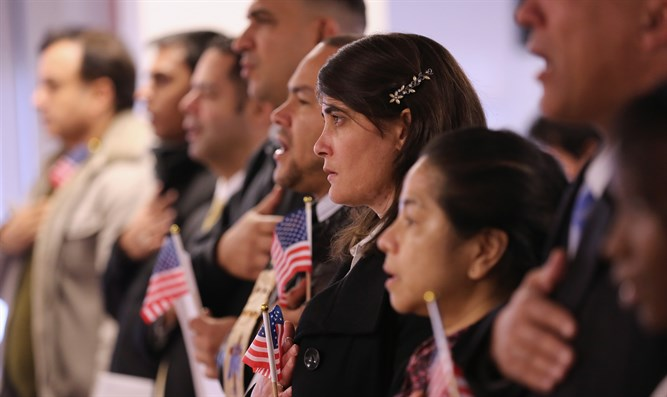 Immigrants taking their oath of U.S. citizenship at the Federal Building in Newark