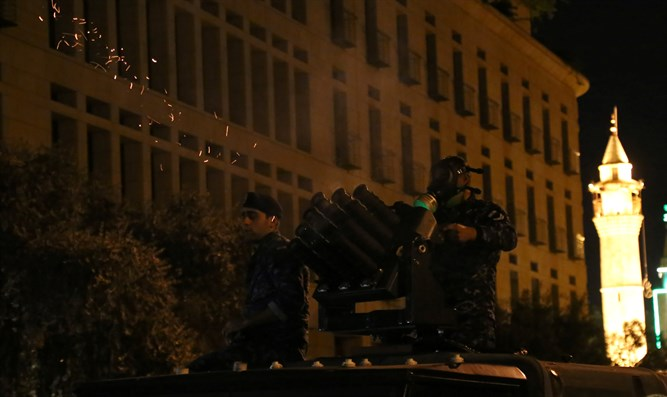 Riot police fire tear gas during anti government protests in Beirut