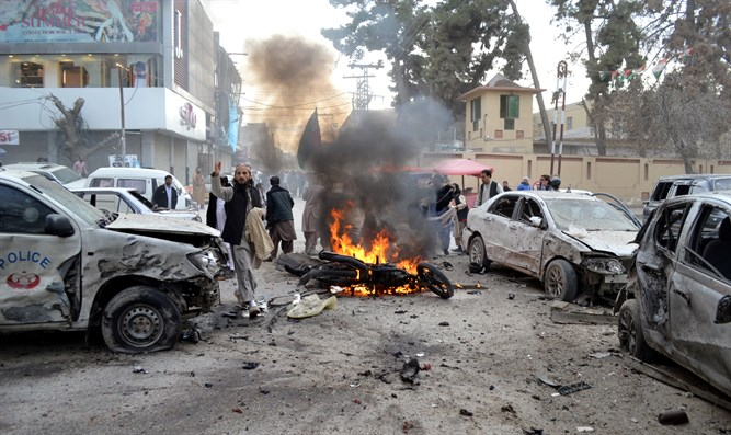 People gather at site of bomb blast in Quetta