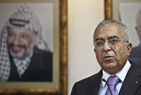PA PM Fayyad with PLO Chairman Arafat on wall
