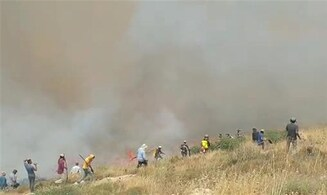 Fire rages outside of Israeli town in Samaria
