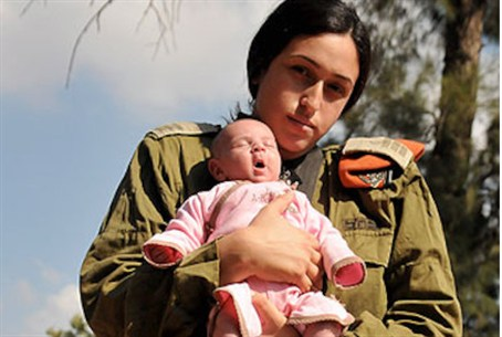Combat officer Shukrun and her baby girl