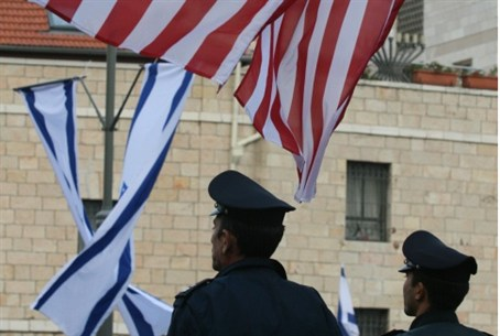 American and Israeli flags hang in Jerusalem