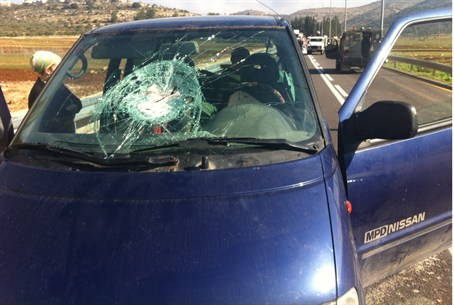 Car after rock attack (illustrative)