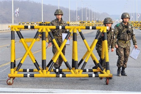 South Korean soldiers set barricades on a roa