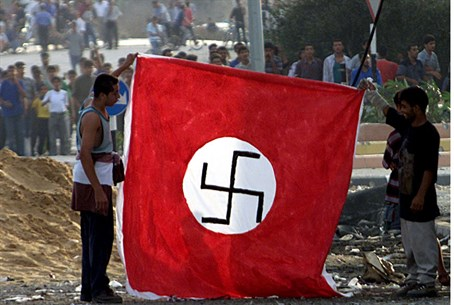 Palestinian Arabs hold Nazi flag at Netzarim