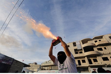 Arab rioter shoots fireworks at police in Jer