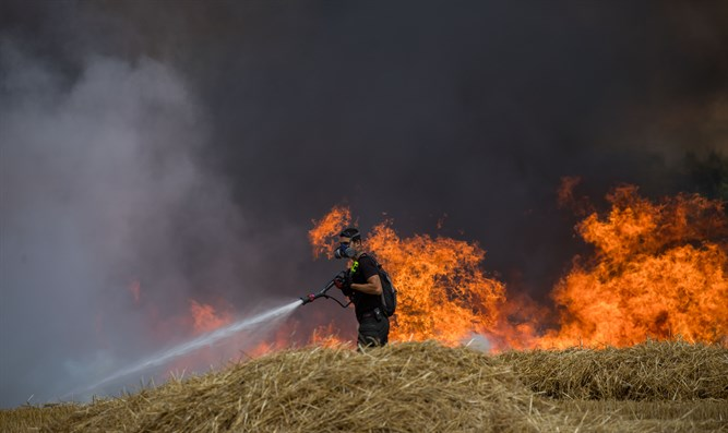 Firefighters extinguish fire in wheat field caused by Gaza incendiary kites