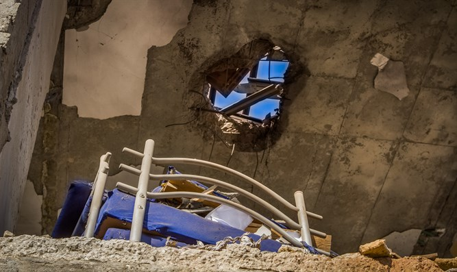 Building hit by rocket fired from Gaza in Beer Sheva