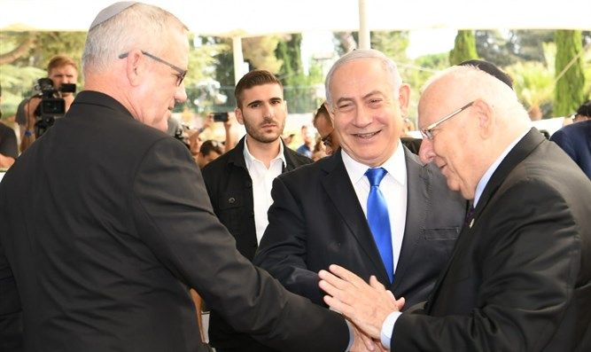 Netanyahu and Gantz shake hands as Rivlin approves