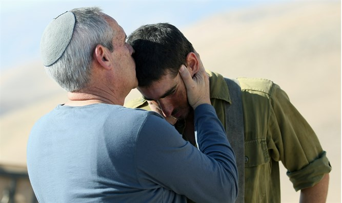 Father kisses son who just completed grueling stretcher march